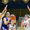 Dixon's Brooke Bailey splits the Rochelle defense for a basket Tuesday night.