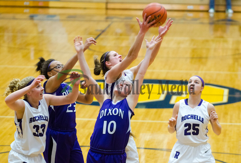 Dixon's Kacie Dillow goes up for a rebound with Rochelle's Abby Gould Tuesday night.