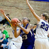 Dixon's Carly Hartle goes up for a shot against Rochelle's Michelle Dobbs Tuesday night.
