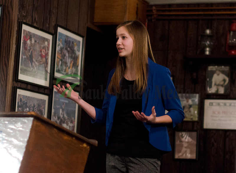 Abigail Gunderson, a 8th grader a Challand Middle School motions during her speech Thursday night at the Sterling Optimist Club Oratorical Contest at the Candlelight Inn. Gunderson was the winner out of the five girls competing and moves onto regional in Des Plaines on April 6th.