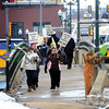 Dixon teachers picket along the Galena Avenue bridge Thursday afternoon as they strike against the school board.