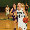 Morgan Mammosser (4) right, runs the ball toward the basket while being followed by Abby Bromenshenkel (23) of Mendota.
