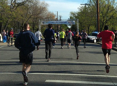 """The home stretch of the race was flanked by law enforcement officers from area jurisdictions and designated as a the """"LaboyStrong Mile,"""" in honor of Alexandria police officer Peter Laboy"""