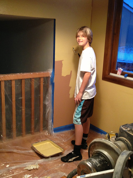 Making that wall match the rest of the kitchen (and covering drywall where family room ceiling was repaired).