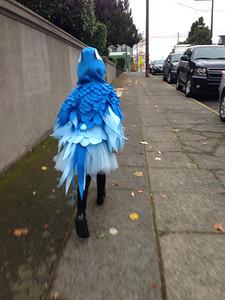 "Halloween morning - Amelia ""flies"" down the street to school"