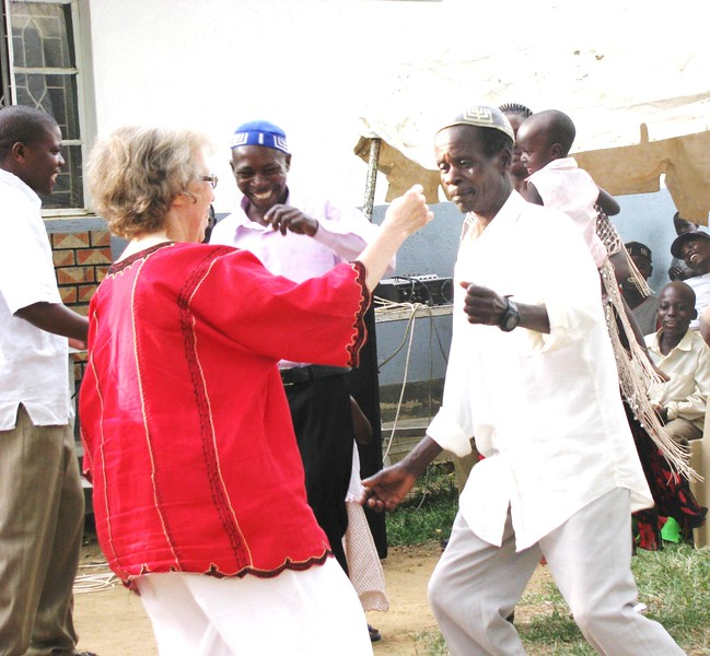 Harriet dancing with JJ Keki at his 50th birthday celebration on Nabugoye Hill outside Gershom's home. Photo by Laura Wetzler.<br><br>Dropped off by Enid