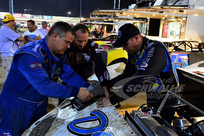 Chris Simpson (right) and Brian Birkhofer (center) help Jimmy Mars (left) make repairs