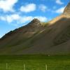 Rock face and pastures southwest of Hvammsfjörður