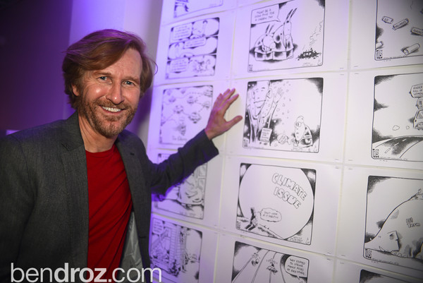 """Tom Toles,  Art Soiree hosts """"First-Term Retrospective"""", a collection of critically acclaimed editorial cartoons.  MalMaison, Georgetown.  Photo by Ben Droz."""