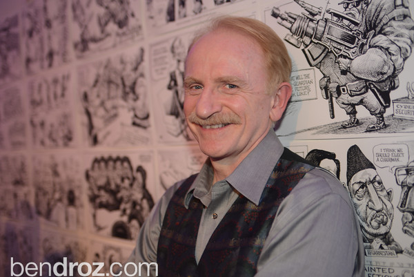 """Kal Kallaugher,  Art Soiree hosts """"First-Term Retrospective"""", a collection of critically acclaimed editorial cartoons.  MalMaison, Georgetown.  Photo by Ben Droz."""