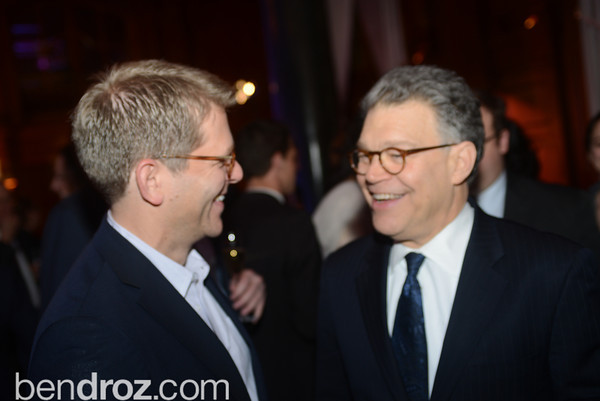 Jay Carney laughs with Senator Al Franken