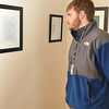Gardner-Webb Student, Andrew Slesinger observes the work of Joseph Gascho.