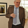 Joseph Gascho, feautrued artist, talks with attendees about his art work.
