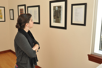 Gardner-Webb Student, Hannah Mayfield observes the work of Joseph Gascho.