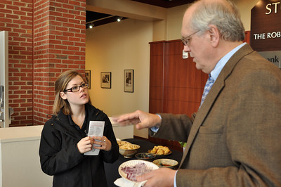 Gardner-Webb Nursing Student, Hannah Winn talks with artist Joseph Gascho about the medical side to his work.