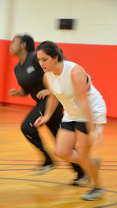 Leigh Roach hustles down the court while playing intramural coed basketball.