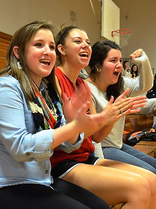 Ashtin Stewart, Hannah Covington and Carson Thompson cheer on their friends at the intramural basketball game.