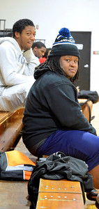 Almonty Abney and DJ Andrews sit and watch other teams play basketball.