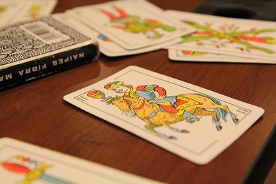 Students play a Spanish game with Spanish cards from Argentina.