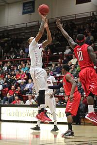 Tashan Newsome(3) shoots for a three pointer.