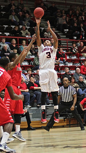 Tashan Newsome(3) shoots for a three pointer.