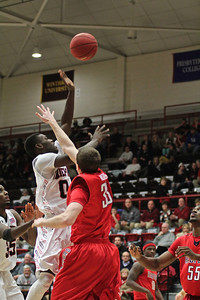 Donta Harper(0) goes for a layup.