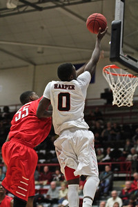 Donta Harper(0) tries to block Radfords shot by the goal.