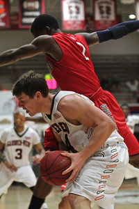 Kevin Hartley(24) battles off a Radford player to keep the ball.