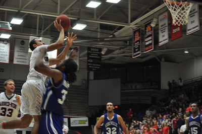 GWU Onzie Branch is fouled during his shot against UNC Asheville