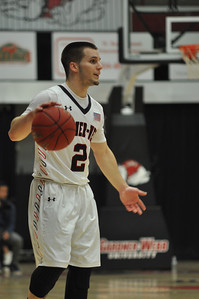GWU Tyler Strange looks for a pass option against UNC Asheville
