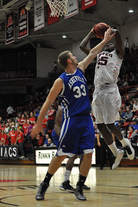 GWU Jerome Hill shoots a lay-up against UNC Asheville