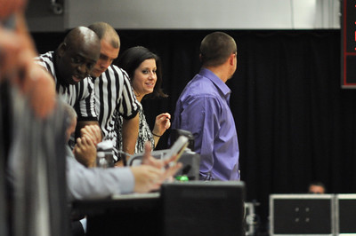 The refs take time to review the video of a questionable foul