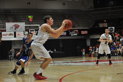 GWU Kevin Hartley shoots a wide-open 3 point shot against UNC Asheville