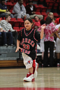 During the Half time show two kids from the  crowd are chosen. They race to see who can put on a Runnin' Bulldog uniform the fastest and make one basket at the end of the court.