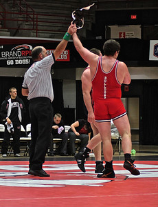 GWU Wrestlers battle out a close match with NC State.