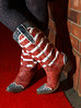 Susan Mock wearing flag boots.  The 2013 Coors Western Art Exhibit and Sale Red Carpet Reception at the National Western Stock Show Complex in Denver, Colorado, on Tuesday, Jan. 8, 2013.<br /> Photo Steve Peterson