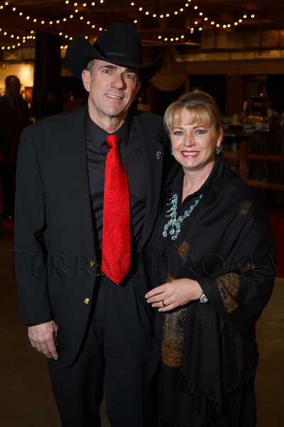 Wayne and Susan Bichel.  Susan is wearing a vintage turquoise and silver necklace that Wayne's father found in Arizona for his mother about 40 years ago.  The 2013 Coors Western Art Exhibit and Sale Red Carpet Reception at the National Western Stock Show Complex in Denver, Colorado, on Tuesday, Jan. 8, 2013.<br /> Photo Steve Peterson