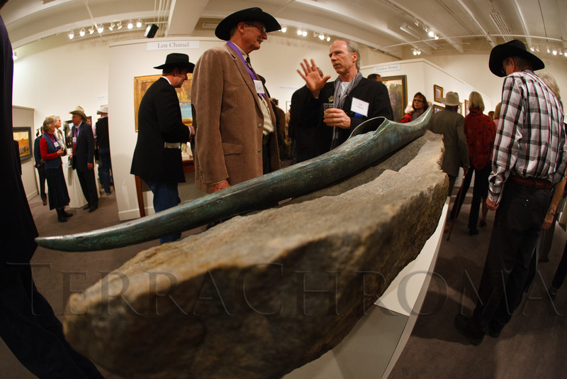 "Gary Moore speaks with artist, Neil Clifford, about his bronze, ""Ocean Swell.""  The 2013 Coors Western Art Exhibit and Sale Red Carpet Reception at the National Western Stock Show Complex in Denver, Colorado, on Tuesday, Jan. 8, 2013.<br /> Photo Steve Peterson"