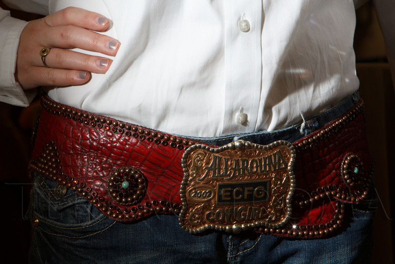 McKenzi Digby wearing her buckle with a belt bought at the National Finals Rodeo in Las Vegas.  The 2013 Coors Western Art Exhibit and Sale Red Carpet Reception at the National Western Stock Show Complex in Denver, Colorado, on Tuesday, Jan. 8, 2013.<br /> Photo Steve Peterson
