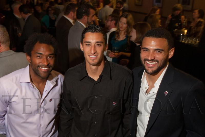 "With the Colorado Rapids:  Marvell Wynne, Tony Cascio, and Andre Akpan.  ""Mile High Dreams Gala,"" benefiting Kroenke Sports Charities, at the Pepsi Center in Denver, Colorado, on Monday, Jan. 21, 2013.<br /> Photo Steve Peterson"
