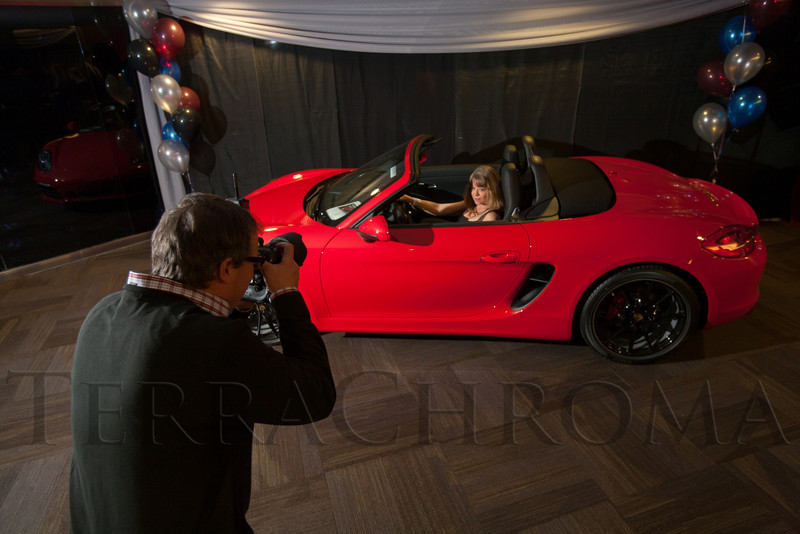 "Claudia Locklin in the Porsche.  ""Mile High Dreams Gala,"" benefiting Kroenke Sports Charities, at the Pepsi Center in Denver, Colorado, on Monday, Jan. 21, 2013.<br /> Photo Steve Peterson"