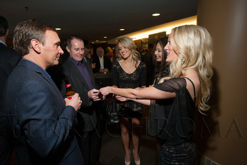 "Mike Kehoe and John Schultz buy ""Mystery Cards"" from Wild Bunch dancers, Emily Maginnis, Masako Pelkey, and Kate Percy.  ""Mile High Dreams Gala,"" benefiting Kroenke Sports Charities, at the Pepsi Center in Denver, Colorado, on Monday, Jan. 21, 2013.<br /> Photo Steve Peterson"