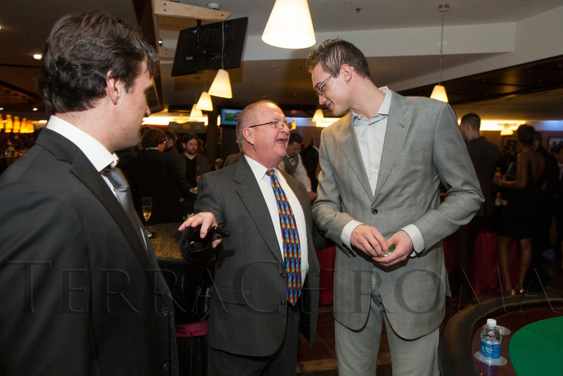 "Rick Giles and his father, Rich Giles, speak with Danilo Gallinari.  ""Mile High Dreams Gala,"" benefiting Kroenke Sports Charities, at the Pepsi Center in Denver, Colorado, on Monday, Jan. 21, 2013.<br /> Photo Steve Peterson"