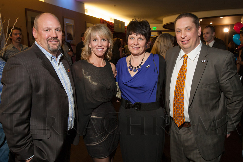 "Steve (Colorado Mammoth general manager) and Eileen Govett with Lisa and Bob (Colorado Mammoth head coach) Hanley.  ""Mile High Dreams Gala,"" benefiting Kroenke Sports Charities, at the Pepsi Center in Denver, Colorado, on Monday, Jan. 21, 2013.<br /> Photo Steve Peterson"