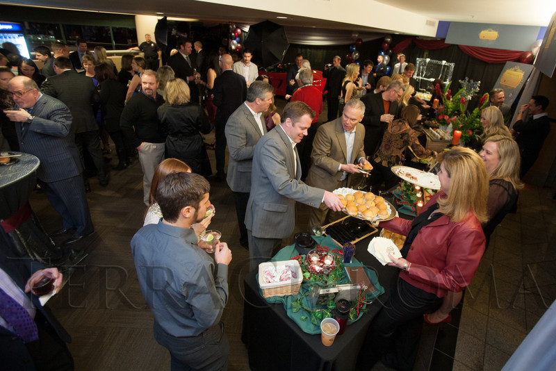 "Among the many snacks available are lobster salad sliders from The Palm.  ""Mile High Dreams Gala,"" benefiting Kroenke Sports Charities, at the Pepsi Center in Denver, Colorado, on Monday, Jan. 21, 2013.<br /> Photo Steve Peterson"
