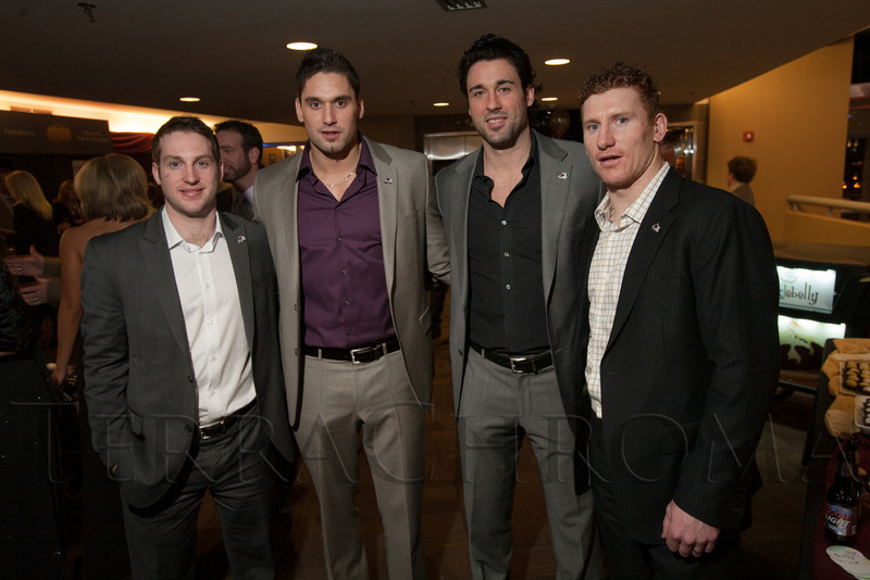 "With the Colorado Avalanche:  Mark Olver, Patrick Bordeleau, Ryan O'Byrne, and Cody McLeod.  ""Mile High Dreams Gala,"" benefiting Kroenke Sports Charities, at the Pepsi Center in Denver, Colorado, on Monday, Jan. 21, 2013.<br /> Photo Steve Peterson"