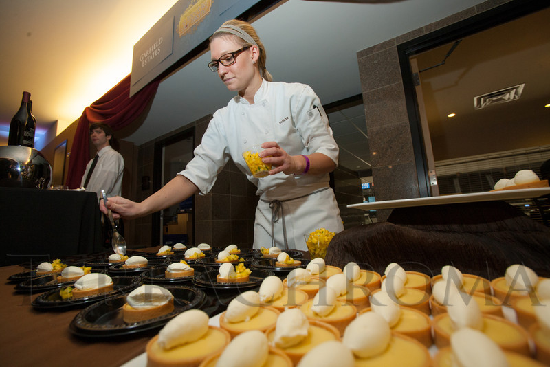 "DBar Desserts:  pastry chef Briana White prepares key lime tarts with white chocolate cream and tropical relish.  ""Mile High Dreams Gala,"" benefiting Kroenke Sports Charities, at the Pepsi Center in Denver, Colorado, on Monday, Jan. 21, 2013.<br /> Photo Steve Peterson"