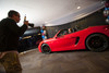 "Garrett Ellwood takes a photo of Betsy Fordyce in a Porsche.  ""Mile High Dreams Gala,"" benefiting Kroenke Sports Charities, at the Pepsi Center in Denver, Colorado, on Monday, Jan. 21, 2013.<br /> Photo Steve Peterson"