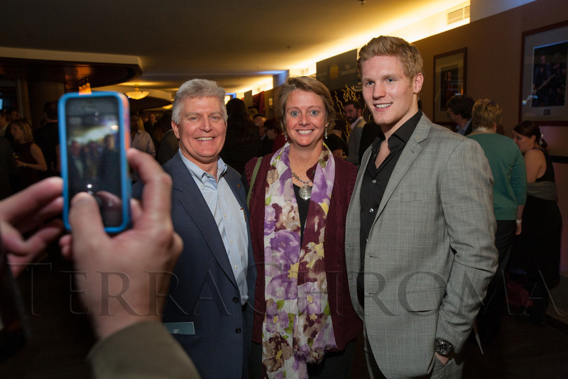 "Alan and Laura Magnuson get a photo with Gabriel Landeskog.  ""Mile High Dreams Gala,"" benefiting Kroenke Sports Charities, at the Pepsi Center in Denver, Colorado, on Monday, Jan. 21, 2013.<br /> Photo Steve Peterson"