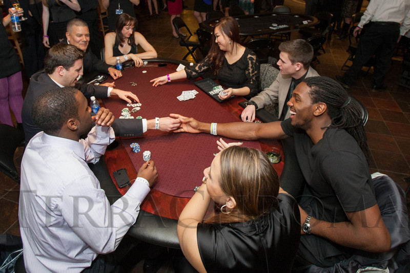 "Kenneth Faried at the poker table.  ""Mile High Dreams Gala,"" benefiting Kroenke Sports Charities, at the Pepsi Center in Denver, Colorado, on Monday, Jan. 21, 2013.<br /> Photo Steve Peterson"